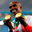 Mo Farah with his 5,000 m and 10,000m gold medals. Photo: Martin Rickett/PA Wire