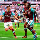 Michail Antonio (No 30) celebrates with Ashley Fletcher and Sam Byram after scoring. Photo: Getty