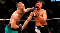 Conor McGregor lands a punch on Nate Diaz. Photo by Steve Marcus/Getty Images