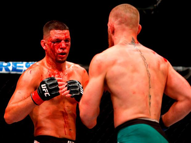 A bloodied Diaz prepares to defend himself. Photo: Steve Marcus/Getty Images