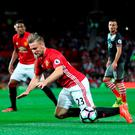 Manchester United's Luke Shaw goes down during the Premier League match at Old Trafford