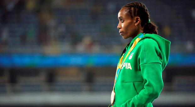 Almaz Ayana (ETH) of Ethiopia poses with her bronze medal.