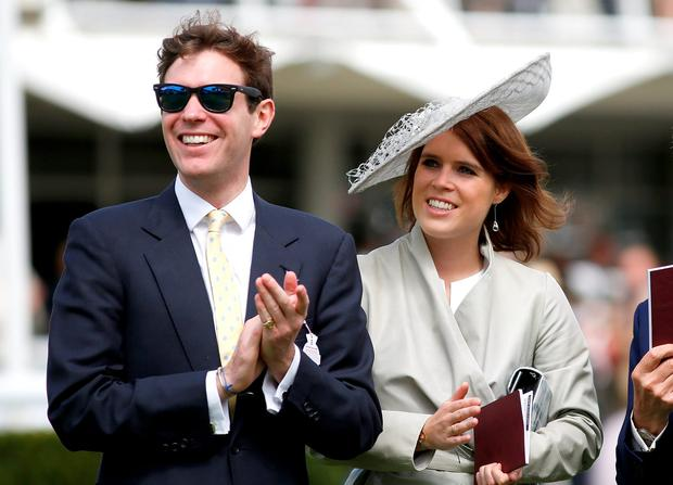 Princess Eugenie and Jack Brooksbank (L) attend day three of the Qatar Goodwood Festival at Goodwood Racecourse on July 30, 2015 in Chichester, England. (Photo by Tristan Fewings/Getty Images for Qatar Goodwood Festival)