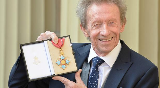 LONDON, UNITED KINGDOM - MARCH 11: Former Scotland and Manchester United footballer Denis Law poses with his Commander of the Order of the British Empire (CBE) medal that was presented to him by the Duke of Cambridge during an Investiture ceremony at Buckingham Palace on March 11, 2016 in London, United Kingdom. (Photo by John Stillwell - WPA Pool/Getty Images)