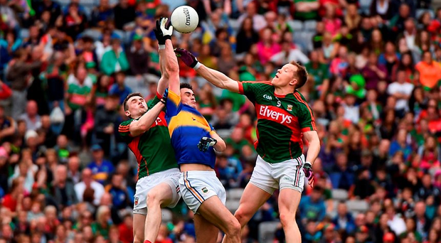 Michael Quinlivan competes for the high ball with Mayo's Patrick Durcan (L) and Donal Vaughan on Sunday. Photo: Ray McManus/Sportsfile