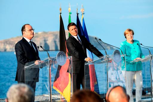 French President Francois Hollande, Italian Prime Minister Matteo Renzi and German Chancellor Angela Merkel give a joint press conference aboard an aircraft carrier in the harbour of Italian island of Ventotene. Photo: AFP/Getty Images