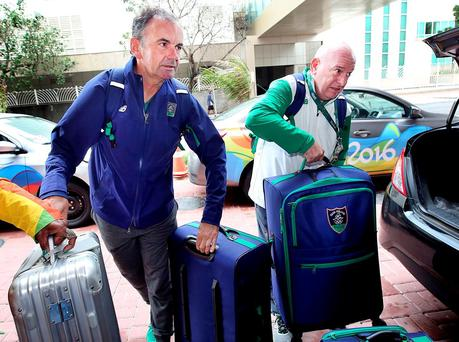 Stephen Martin, chief executive of the Olympic Council of Ireland, and Kevin Kilty, OCI chef de mission, checking into a new hotel in Rio de Janeiro yesterday. Their passports were seized by Rio police investigating the ticket touting scandal. Photo: Steve Humphreys