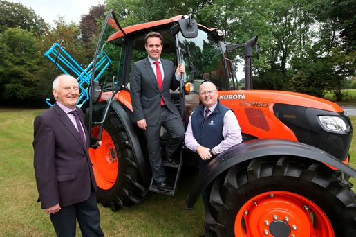 Fintan Murphy, Managing director, of Murphy Machinery, Kilkenny; Geoff Lyons, group marketing director at Independent Newspapers, and Colm Blake, marketing manager of Zurich insurance, beside the Kubota M9960 tractor and Berthoud Alto 800 litre sprayer. Photo: Damien Eggers