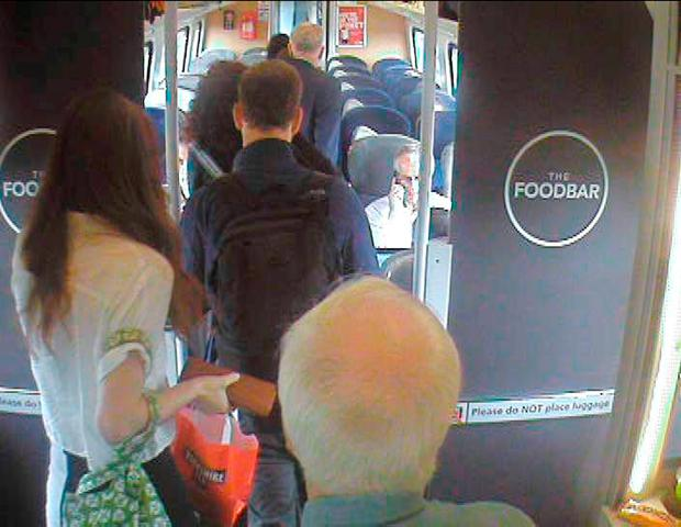 Handout CCTV footage dated 11/08/16 issued by Virgin Trains which was filmed at 11.07am, approximately 7 min after departure from King's Cross in central London, showing Labour Party leaderJeremy Corbyn (top right), walking past several empty, unreserved seats in Coach H, after a video emerged last week which showed Mr Corbyn sitting on the floor, reading a newspaper, and saying