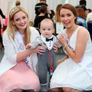 Seven month old Oisin O Donnell from Tralee poses for pictures with Down Rose Fainche McCormack and Clare Rose Leah Kenny, at the Dome in Tralee. Photo: Frank Mc Grath