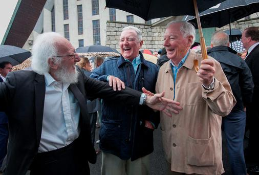 Eamonn Campbell of The Dubliners with broadcasters Mike Murphy and Gay Byrne at the funeral of Louis Stewart in Greenhills, Dublin. Photo: Gareth Chaney Collins