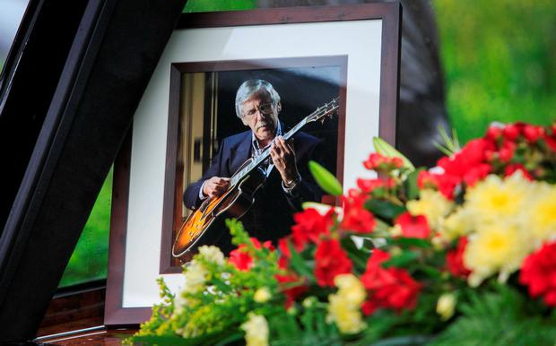 A photo of the late guitarist at his funeral. Photo: Gareth Chaney