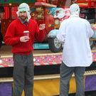 Bob McGlynn, AKA Mr Chrome (left), and Dave Chambers (Blind Boy Boat Club) of The Rubberbandits take a break during filming at a merry-go-round in Bray, Co Wicklow. Photo: Mark Doyle