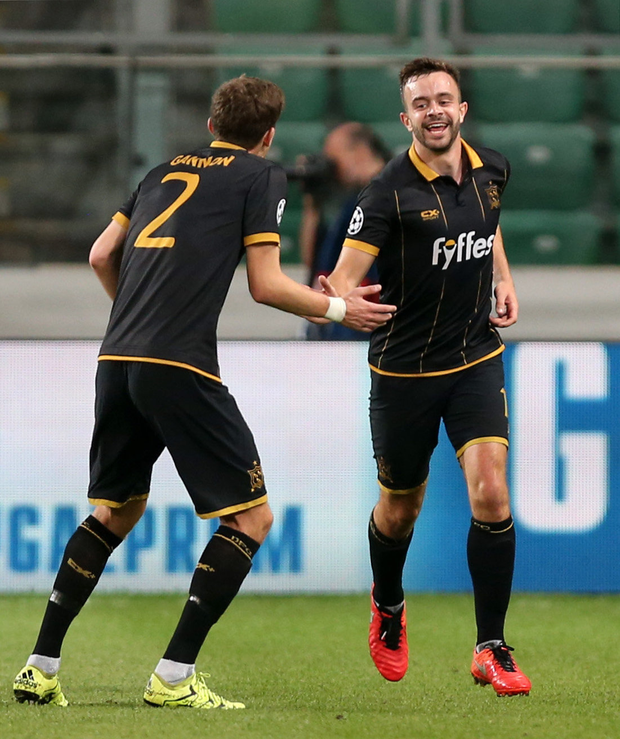 Robert Benson of Dundalk FC is congratulated by team-mate Sean Gannon after scoring his side's first goal Photo by Piotr Kucza/Sportsfile