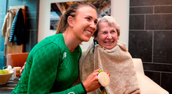 Annalise Murphy is welcomed home by her grandmother Betty Murphy at Dublin Airport yesterday. Photo: Sportsfile