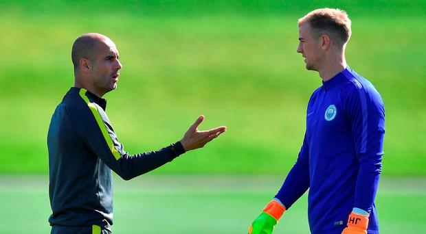 Pep Guardiola and Joe Hart exchange words during Manchester City's training session yesterday Photo: Dave Howarth/PA Wire