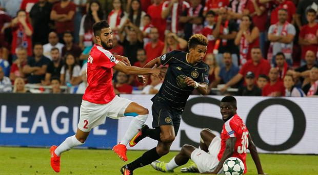 Hapoel's Ben Bitton (L) tries to tackle Celtic's Scott Sinclair (C) during the UEFA Champions League group stages play-off football match between Celtic and Hapoel Beer Sheva at the Turner Stadium in the southern Israeli city of Beer Sheva on August 23, 2016. The game is being played in the most southerly stadium in European competition history, UEFA confirmed. / AFP / GIL COHEN-MAGEN (Photo credit should read GIL COHEN-MAGEN/AFP/Getty Images)