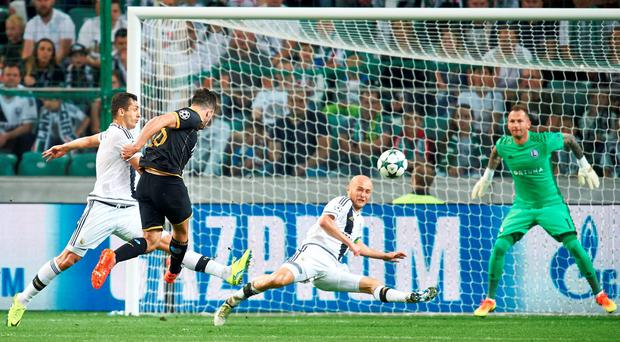Robbie Benson scores Dundalk's goal against Legia Warsaw last night (Photo by Adam Nurkiewicz/Getty Images)