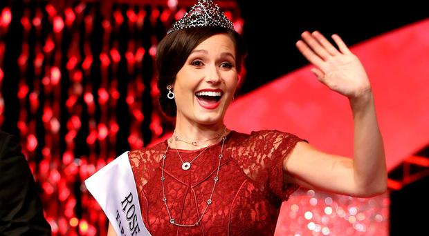 Chicago Rose and Rose of Tralee winner Maggie McEldowney waves to the crowd after her victory