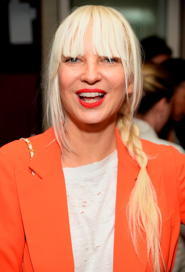 Recording artist Sia attends ELLE's Annual Women in Television Celebration on January 13, 2015 at Sunset Tower in West Hollywood, California. Presented by Hearts on Fire and Olay. (Photo by Michael Kovac/Getty Images for Elle/Hearts On Fire)