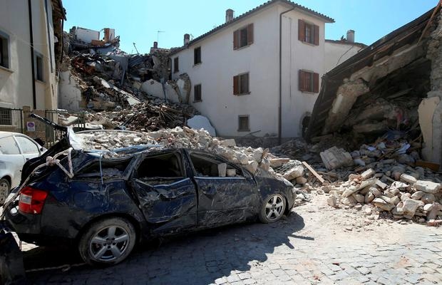 A destroyed car is seen following an earthquake in Amatrice, central Italy, August 24, 2016. REUTERS/Stefano Rellandini