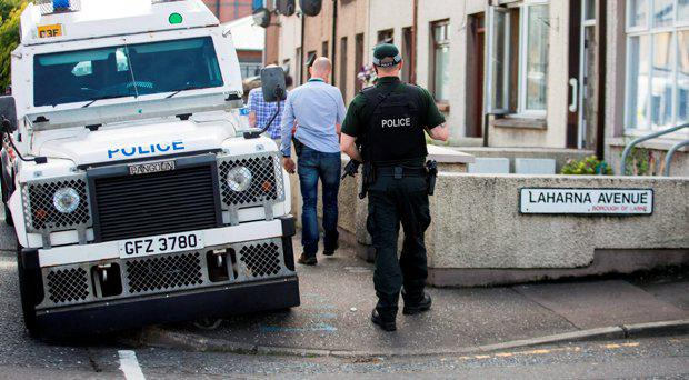 PSNI officers and Army technical officers search properties on Old Glenarm Road in Larne, Co Antrim. A Royal Marine is being questioned by detectives investigating Northern Ireland-linked terrorism, understood to be connected to two major dissident republican arms finds