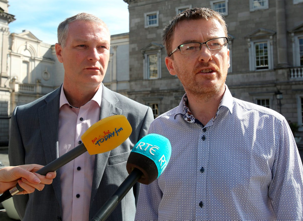 Sinn Féin spokesman for workers' rights David Cullinane (right) with SF TD Martin Kenny at Leinster House Photo: Tom Burke