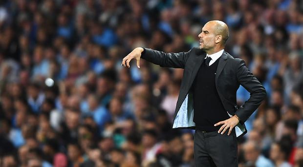 MANCHESTER, ENGLAND - AUGUST 24: Josep Guardiola, Manager of Manchester City gives instructions during the UEFA Champions League Play-off Second Leg match between Manchester City and Steaua Bucharest at Etihad Stadium on August 24, 2016 in Manchester, England. (Photo by Michael Regan/Getty Images)
