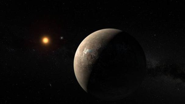 An artist's impression issued by the European Southern Observatory showing the planet Proxima b orbiting the red dwarf star Proxima Centauri