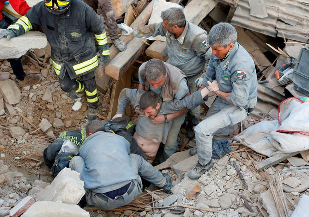 A man pulled from the rubble Photo: REUTERS/Remo Casilli
