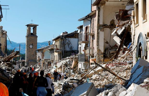 In the nearby town of Amatrice, the main street in ruins Photo: REUTERS/Stefano Rellandini