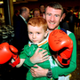 Boxer Paddy Barnes with Joel Thomas (5), from Baldoyle, Co Dublin, at Dublin Airport Photo: Seb Daly/Sportsfile
