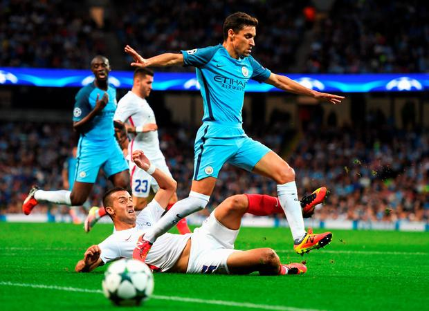 Marko Momcilovic tackles Jesus Navas (Photo by Michael Regan/Getty Images)