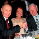 Lawyer Simone Kamenetz (left) and President of the Russian Federation Vladimir Putin, Pat Hickey and his wife Sylviane (right)