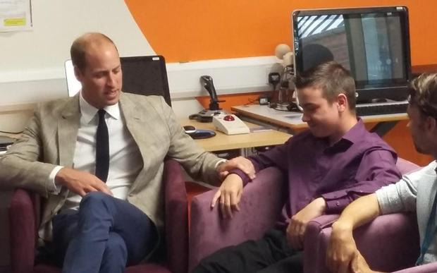Britain's Prince William comforts grieving boy Ben Hindes (14). Photo: PA