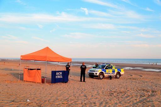 Police officers on Camber Sands near Rye