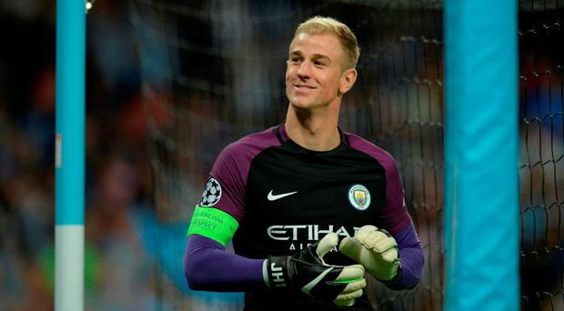 Manchester City's English goalkeeper Joe Hart gestures to members of the crowd as he comes out for the second half during the UEFA Champions league second leg play-off football match between Manchester City and Steaua Bucharest at the Etihad Stadium