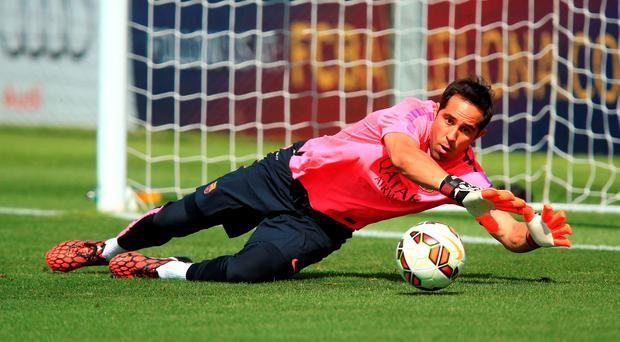 Manchester City have signed Chile goalkeeper Claudio Bravo from Barcelona on a four-year deal, the Premier League side have announced. Mike Egerton/PA Wire.
