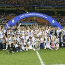 Real Madrid winner of UEFA Champions League 2015 2016 with Champions League trophy, Coupe des clubs Champions Europeeens, Cristiano Ronaldo of Real Madrid, Karim Benzema of Real Madrid. Luka Modric of Real Madrid, Gareth Bale of Real Madrid, Toni Kroos of Real Madrid, Daniel Carvajal of Real Madrid, Marcelo of Real Madrid, Casemiro of Real Madrid, Pepe of Real Madrid, goalkeeper Keylor Navas of Real Madrid, Sergio Ramos of Real Madrid, Raphael Varane of Real Madrid, Nacho of Real Madrid, James Rodriguez of Real Madrid, goalkeeper Kiko Casilla of Real Madrid, coach Zinedine Zidane of Real Madrid, Mateo Kovacic of Real Madrid, Alvaro Arbeloa of Real Madrid, Lucas Vazquez of Real Madrid, Jese of Real Madrid, Isco of Real Madrid, Danilo of Real Madrid, during the UEFA Champions League final match between Real Madrid and Atletico Madrid on May 28, 2016 at the Giuseppe Meazza San Siro stadium in Milan, Italy.(Photo by VI Images via Getty Images)
