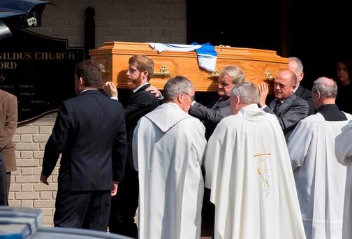 The coffin is carried from St Joseph and St Benildus Church in Waterford after the funeral mass for Milo Corcoran