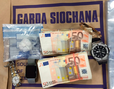 Some of the items seized by gardaí in raids in Dublin include €7,000 in cash, drugs and a €30,000 worth of jewellery, including a Rolex watch