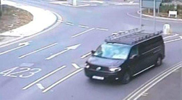 The black van police are searching for in connection with the apparent child snatching Credit: Surrey Police