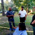 Durant Police Chief John Haynes, left, and assistant Police Chief James Lee reassure Lexington Medical Clinic employees Lisa Dew, right, and Viola Turner, seated, that the Mississippi Bureau of Investigation was giving the home of two slain Catholic nuns who worked as nurses at the clinic a through crime scene investigation, Thursday, Aug. 25, 2016, in Durant