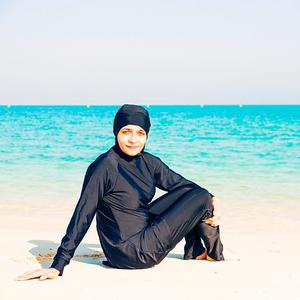 Young woman wearing a burkini