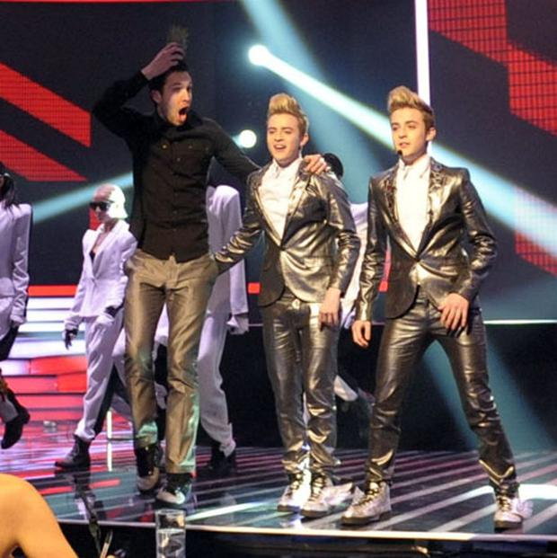 Calvin Harris interrupts Jedward during their performance on The X Factor in 2009. Photo: ITV