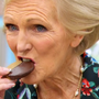 Mary Berry breaks into a cookie on The Great British Bake Off. Photo: ITV