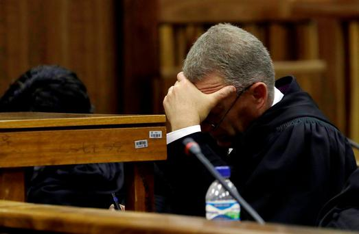 State prosecutor Gerrie Nel looks down as Judge Thokozile Masipa reads her verdict during an appeal hearing brought by prosecutors against the six-year jail term handed to Oscar Pistorius for the murder of his girlfriend Reeva Steenkamp in Johannesburg, South Africa, August 26, 2016