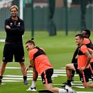 Jurgen Klopp manager of Liverpool with Philippe Coutinho, Roberto Firmino and Divock Origi during a training session at Melwood