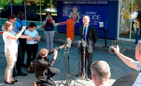Detective Superintendent Chris Edwards from Surrey Police, talks to the media, as police are taking