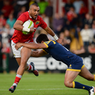 Simon Zebo is tackled by Dean Hammond Photo: Seb Daly/Sportsfile